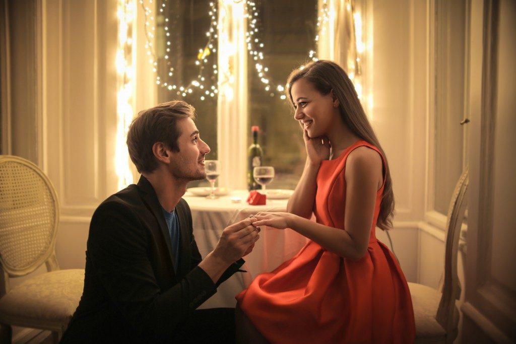 Man proposing in an elegant restaurant