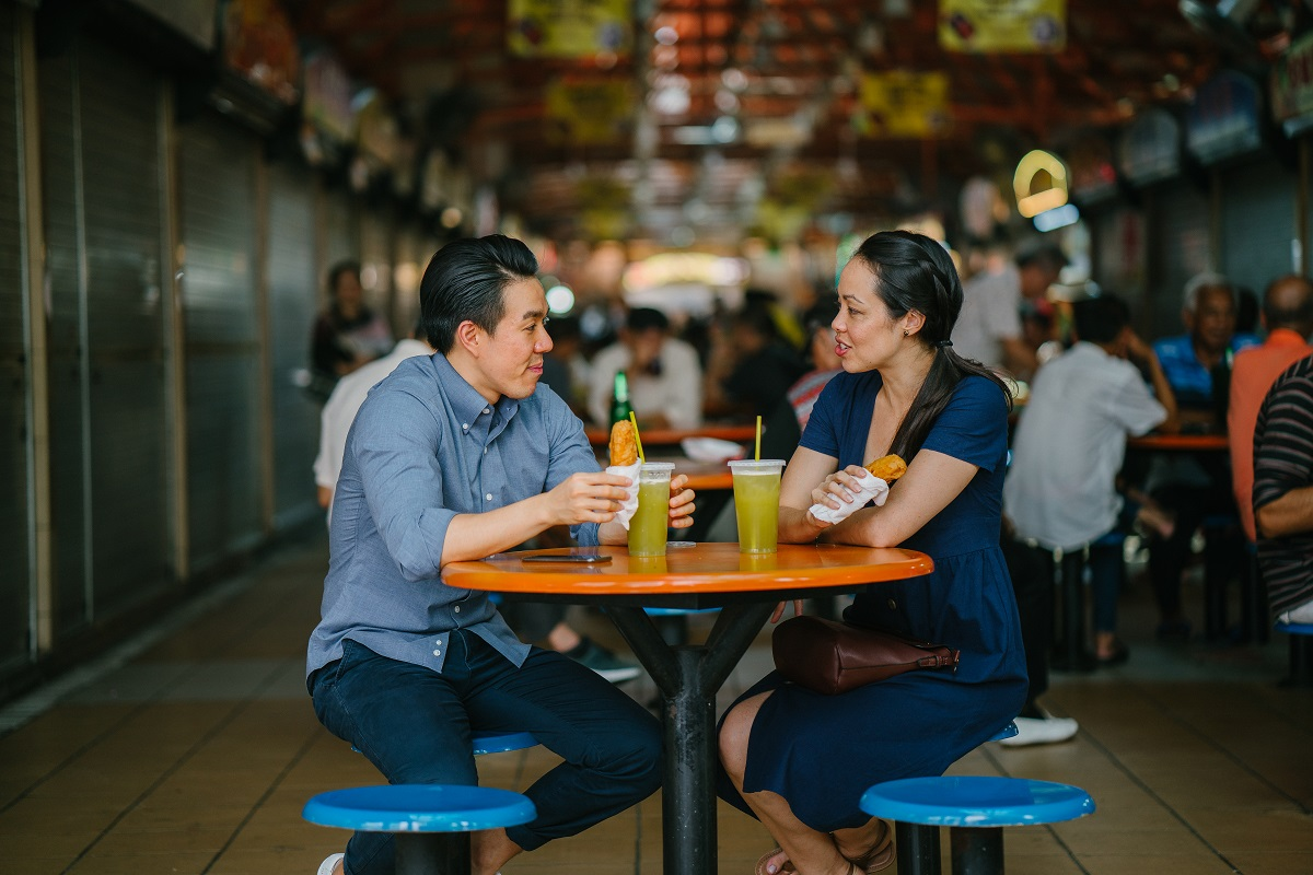 Couple eating at Singapore