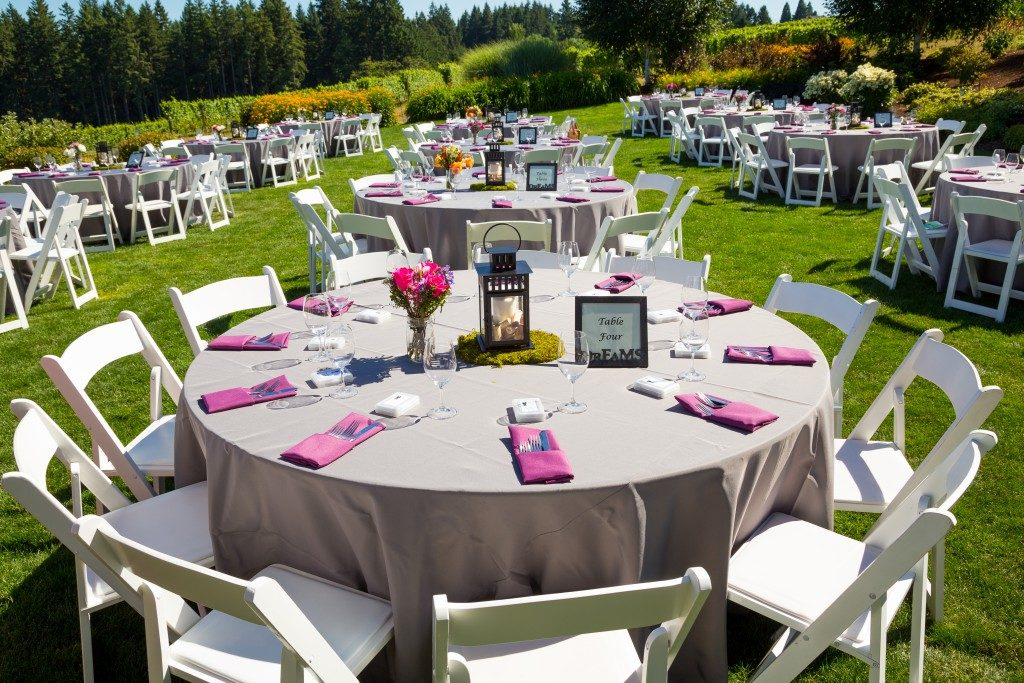 Tables, chairs, decor, and decorations at a wedding reception
