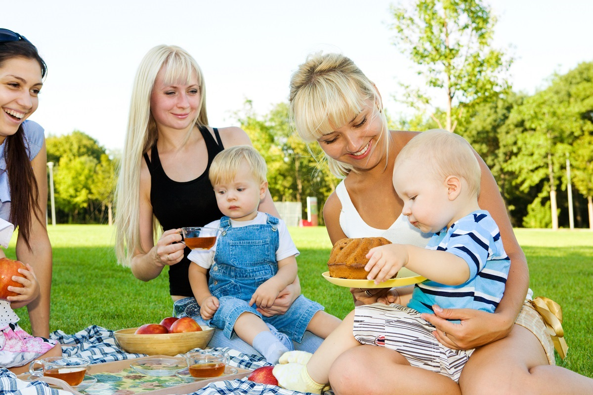 mothers having a picnic with kids
