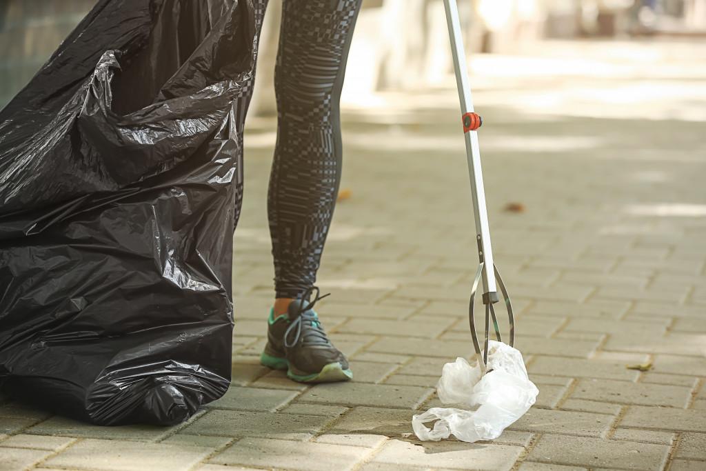 woman gather trash